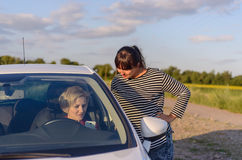 Two women chatting on a rural road Stock Photos