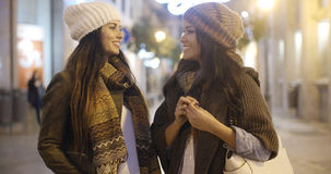 Two women chatting at a street in winter Stock Images
