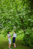 Two Women Chatting Under Tree Royalty Free Stock Images