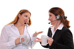 Two women chatting with wearing headsets royalty free stock photos