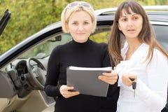 Two women checking a contract Stock Photos