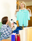 Two women checking purchases Stock Image