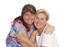 Two Close Friends Posing. Two women cheek to cheek for a photograph, on white background royalty free stock images