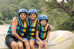 Two women and a child going rafting Stock Photo
