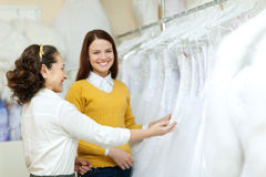 Two women chooses bridal gown Royalty Free Stock Photography