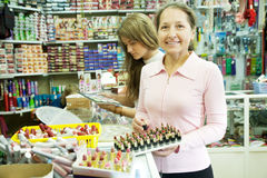 Two women chooses cosmetic Royalty Free Stock Photos