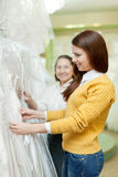 Two women chooses wedding outfit Royalty Free Stock Photography
