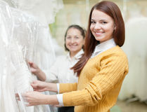 Two women chooses white dress Stock Photo