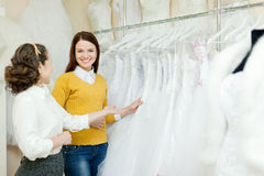 Two women chooses white gown Royalty Free Stock Images
