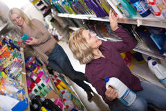 Two women choosing detergents in the shop Stock Images