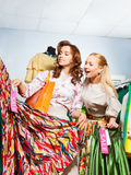 Two women choosing dress during sale Royalty Free Stock Photography