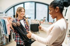 Two women choosing intimate apparel, shopping stock images