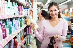 Two women choosing shampoo Stock Photo