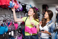 Free Two Women Choosing Underwear In Shop Royalty Free Stock Photos - 56770558