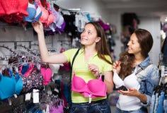Two women choosing underwear in shop Royalty Free Stock Photos