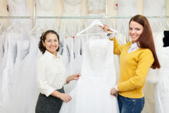 Two women choosing white dress Royalty Free Stock Photography