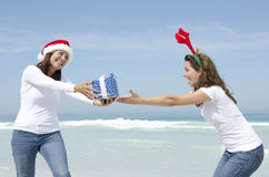 Two women Christmas presents outdoor Stock Images