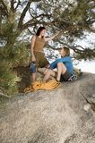 Two women climbers on boulder Royalty Free Stock Images
