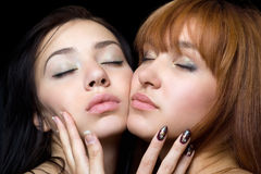 Two women with closed eyes Royalty Free Stock Image