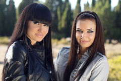 Two women. Closeup of beautiful young girls, outdoors portrait Royalty Free Stock Photography
