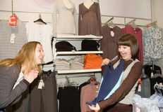 Two women in clothes shop Stock Photo