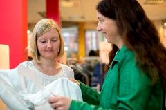 Two women in the clothes shop Royalty Free Stock Photo