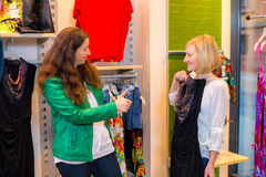 Two women in the clothes shop Stock Image