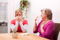 Two women are cold or sad Royalty Free Stock Photography