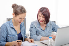 Two women college working on laptop computer Royalty Free Stock Images