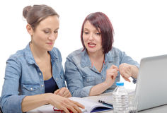 Two women college working on laptop computer Stock Photography