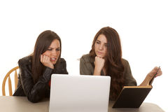 Two women computer book frustrated. Two women are looking at a computer frustrated Stock Photography