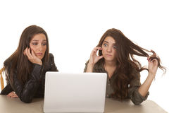 Two women computer frustration. Two women are looking at a computer screen frustrated Royalty Free Stock Photo