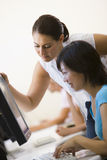 Two women in computer room Stock Images