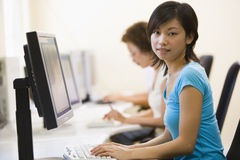 Two women in computer room Stock Photos