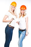 Two women in construction helmets Royalty Free Stock Photo