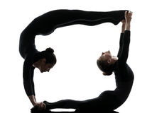 Two women contortionist  exercising gymnastic yoga Royalty Free Stock Image