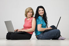 Two women conversation using laptop Royalty Free Stock Photography