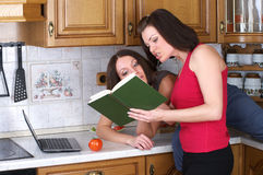 Two women cooking Royalty Free Stock Photo