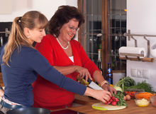 Two Women are cooking Stock Images