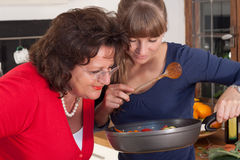 Two women are cooking Stock Photography