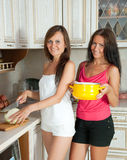Two women cooking at  kitchen Stock Images