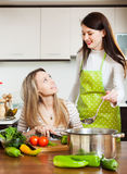 Two women cooking soup together Stock Photo