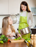 Two women cooking  with vegetables Stock Photography