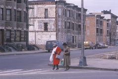 Two women crossing street in ghetto, South Bronx, New York