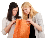 Two women with curiosity look to bag Stock Photo