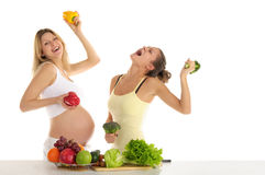 Two women dance with fruits and vegetables stock photo