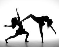 Two women dance on a white background Stock Photos