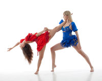 Two women dance on a white background Stock Photography