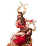 Two women dancers with horns. Isolated on white Royalty Free Stock Photos