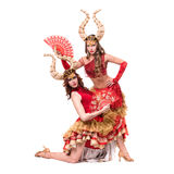 Two women dancers with horns. Isolated on white Royalty Free Stock Photography